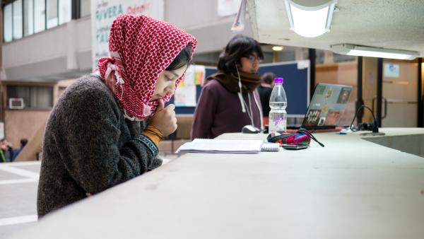 International Students studying at a table