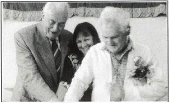The Hon. Gough Whitlam, Clare Petre and Valent Santalab cut the cake at RLC's 15th birthday in March 1992