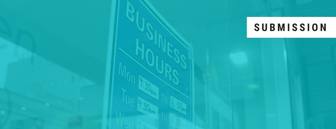 Photo of a shop window sign displaying business hours, shown though and opaque aqua filter