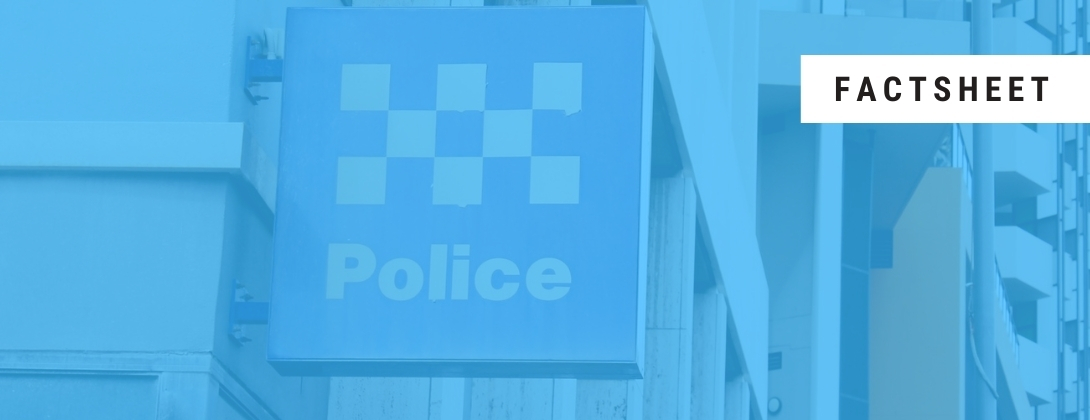 Light blue tinted photo of a police station sign with the word 'factsheet' in a white square in top right corner